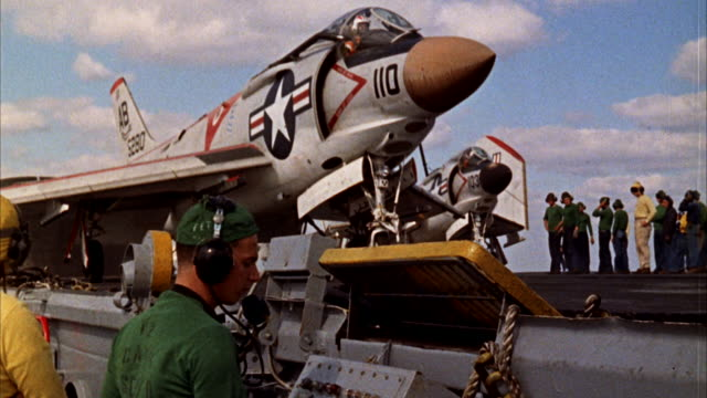 ms view of preparation to launching  jet fighter airplane - ship launch stock videos and b-roll footage