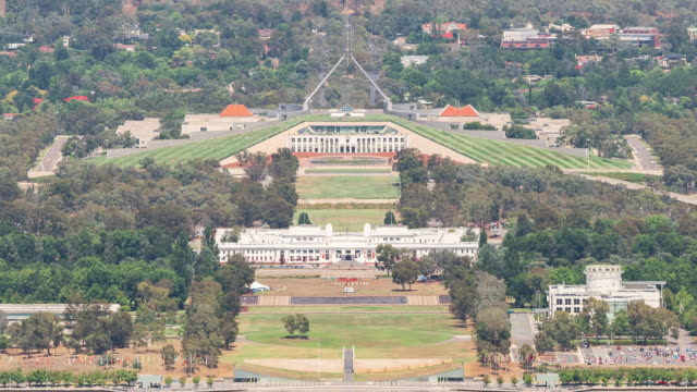 view of previous and current parliament house with parliament square - canberra stock videos & royalty-free footage