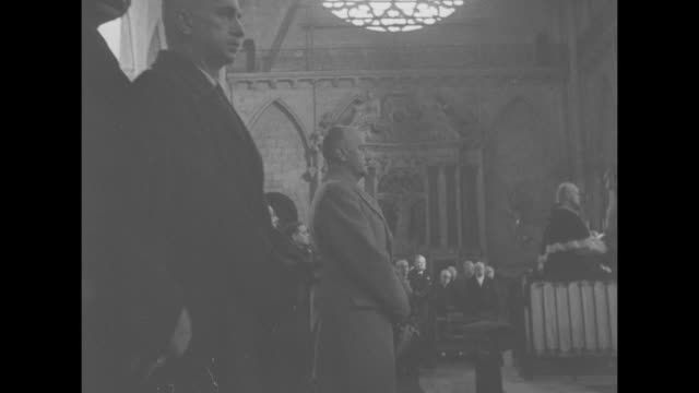 VS view of priests standing in front of cathedral's congregation during ceremony to celebrate the formation of the Polish government in exile...