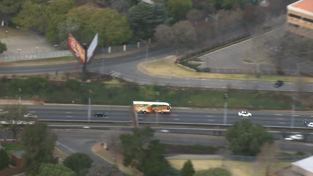 MS AERIAL TS ZO View of pringbok rugby team's bus travelling on highway / Johannesburg, Gauteng, South Africa