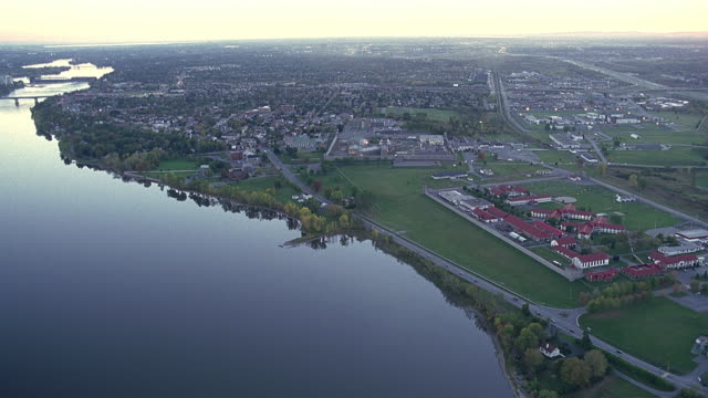 aerial pan ws view of prison and cityscape / montreal, quebec, canada - non urban scene stock videos & royalty-free footage