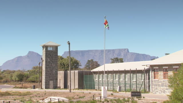 WS View of Prison on Robben Island with Table Mountain / Cape Town, Western Cape, South Africa