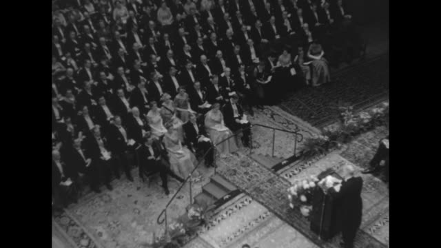 view of prize recipients and dignitaries on stage and audience in stockholm concert hall during nobel prize ceremony / view of prize recipients... - medal stock videos & royalty-free footage