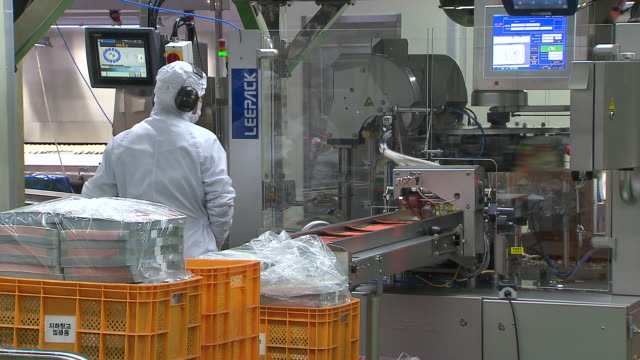 view of process of packing the dumplings - occupational safety and health stock videos and b-roll footage