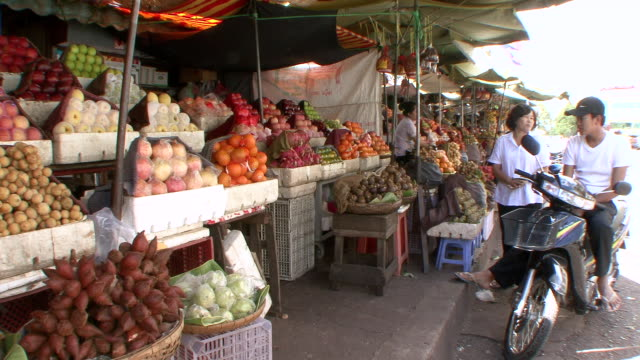 MS View of Produce stand in street market in Phnom Penh / Phnom Penh, Cambodia