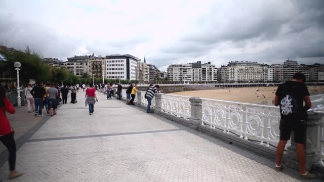 WS PAN View of promenade in La Concha beach / San Sebastian, Guipuzcoa, Spain
