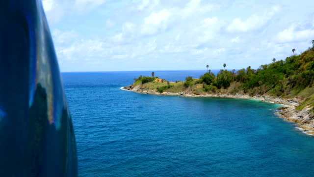 view of promthep cape with blue sky view point at phuket thailand, 4k. - cape stock videos & royalty-free footage
