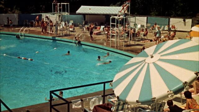 vídeos y material grabado en eventos de stock de ms view of public swimming pool - 1960