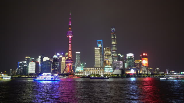 view of pudong skyline with oriental pearl tower and lujiazui business district skyscraper with huangpu river in shanghai, china. - shanghai stock videos & royalty-free footage