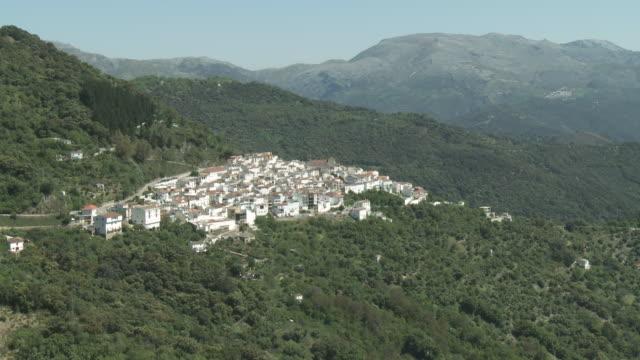 ws view of pueblo blanco at mountain / berarrada, andalusia, spain       - pueblo built structure stock videos & royalty-free footage