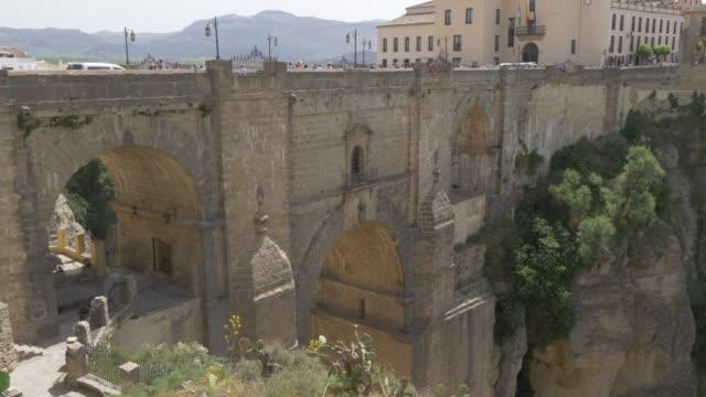 view of puente nuevo and el tajo gorge from mirador de ronda, ronda, andalucia, spain, europe - puente video stock e b–roll