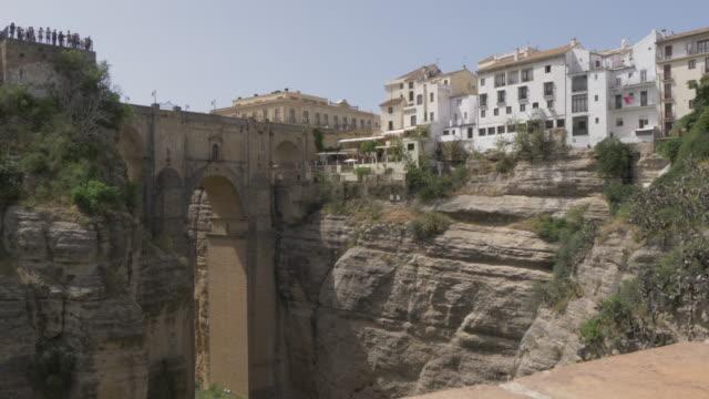 view of puente nuevo and el tajo gorge, ronda, andalucia, spain, europe - puente video stock e b–roll