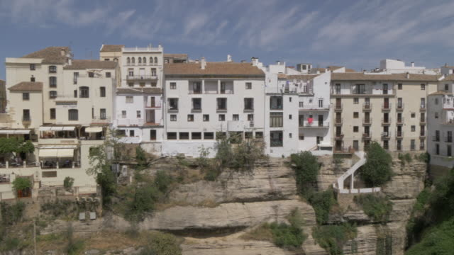 view of puente nuevo and town from south ronda, ronda, andalucia, spain, europe - puente video stock e b–roll