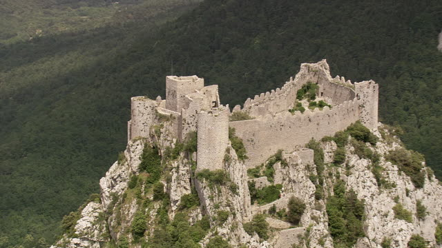WS AERIAL TS ZI View of Puilaurens Cathar Castle with forest / Languedoc Roussillon, France