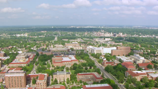 ws aerial pov view of purdue university with city / tippecanoe county, indiana, united states - indiana stock videos & royalty-free footage
