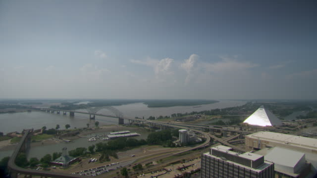 ws view of pyramid arena, mississippi river and hernando de soto bridge / memphis, tennessee, united states - memphis tennessee stock videos and b-roll footage