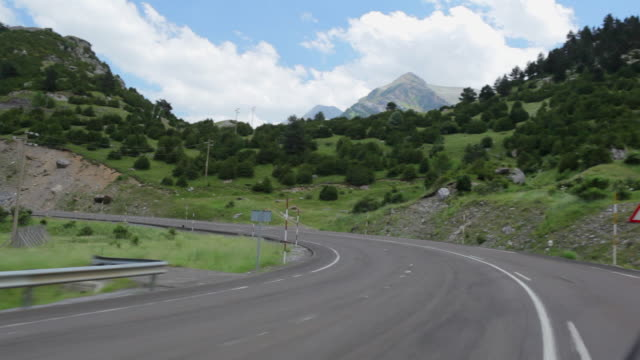 ws pov view of pyrenees mountain road / candanchu, aragon, spain - curve stock videos and b-roll footage