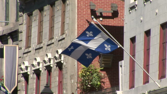 View of Quebec Flag flapping in Montreal Canada