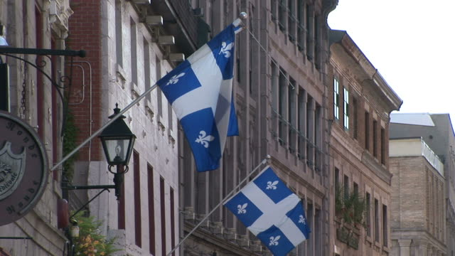 view of quebec flags in montreal canada - ケベックの旗点の映像素材/bロール