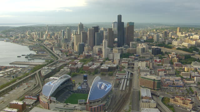 WS AERIAL View of Qwest Field stadium with city skyline  / Seattle, Washington, United States