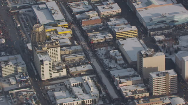 ws aerial ts zi view of racers running on 4th avenue / anchorage, alaska, united states - anchorage alaska stock videos & royalty-free footage