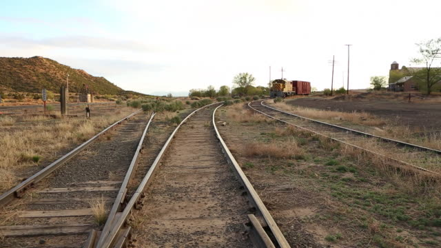 ws pan view of railroad cars on track / lamy, new mexico, united states - lamy new mexico stock videos and b-roll footage