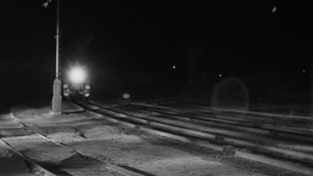 WS View of railroad tracks with train approaching