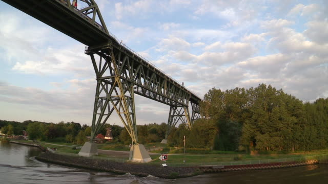 ws view of railway bridge near hochdonn, kiel canal, schleswig holstein / hamburg, germany - schleswig holstein stock videos & royalty-free footage