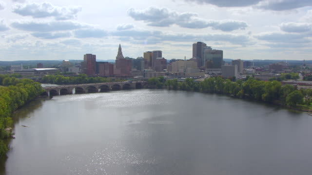 WS AERIAL POV View of railway bridge over Connecticut River, skyline in background / Hartford, Connecticut, United States