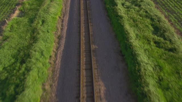 WS AERIAL POV View of Railway track with field / Hardin County, Iowa, United States