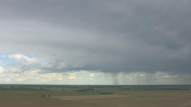 WS AERIAL View of Rain falling on farmland located south of Grand Island / Nebraska, United States