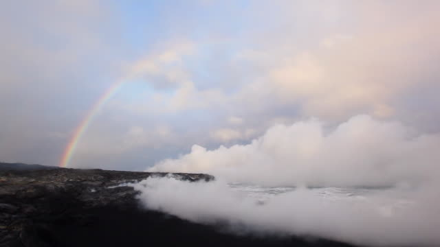 ws t/l view of rainbow appearing above volcanic steam plume / big island, hawaii, united states - kilauea stock videos & royalty-free footage