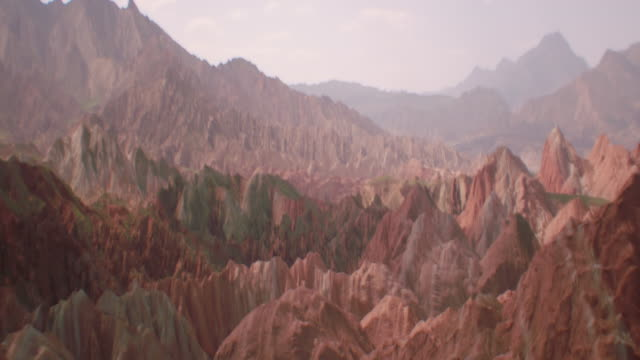 view of rainbow mountains in zhangye danxia landform, china - spiked stock videos & royalty-free footage