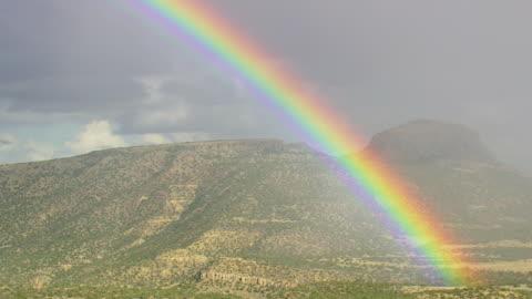 ws aerial view of rainbow over mogollan plateau / arizona, united states - rainbow stock videos & royalty-free footage