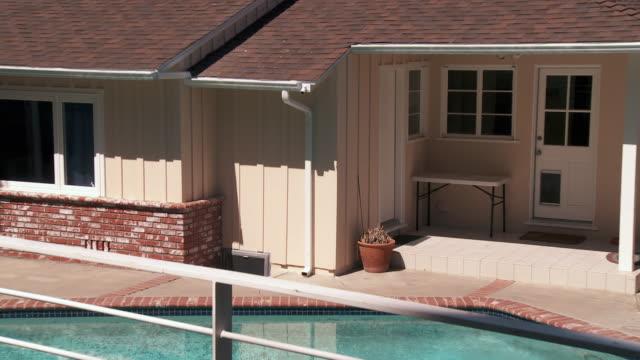 ws zo view of ranch style home backyard with swimming pool / sherman oaks, california, usa.  - sherman oaks stock videos & royalty-free footage