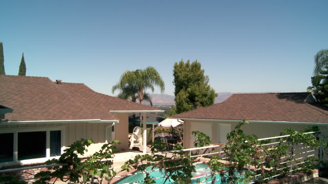 WS TD View of Ranch style home backyard with swimming pool / Sherman Oaks, California, USA.