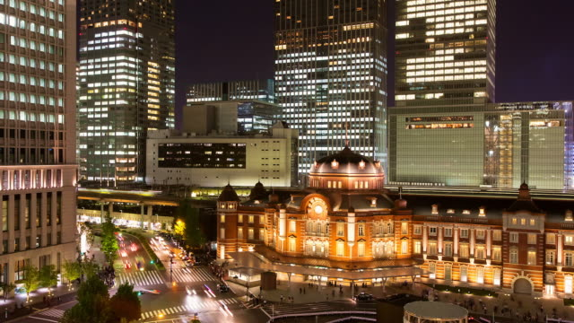 MS T/L View of recently refurbished Tokyo station at night / Tokyo, Japan