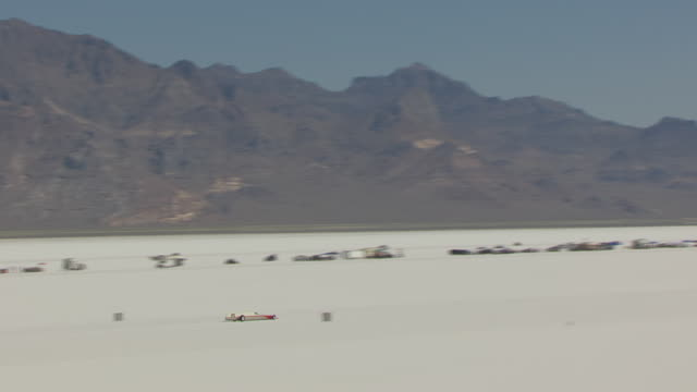ms aerial zo view of red and white rocket car racing at bonneville salt flats during speed week / utah, united states - bonneville salt flats stock videos and b-roll footage