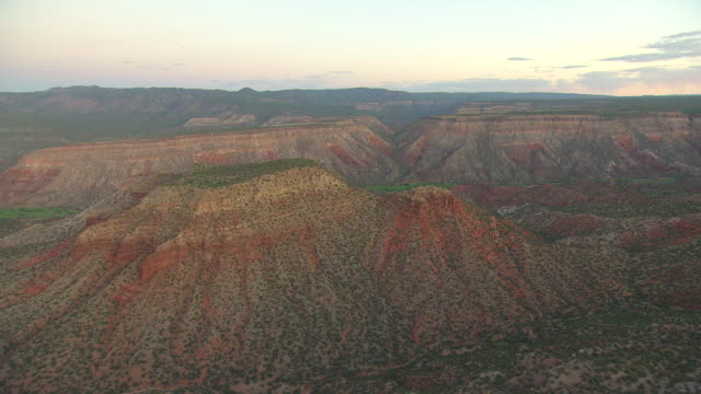 ws aerial view of red desert mesas in morning light in sandoval county / new mexico, united statesv states - mesa stock videos and b-roll footage