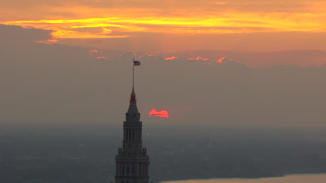 WS AERIAL View of red eclipsing sun in sky during sunset / Cleveland, Ohio, United States