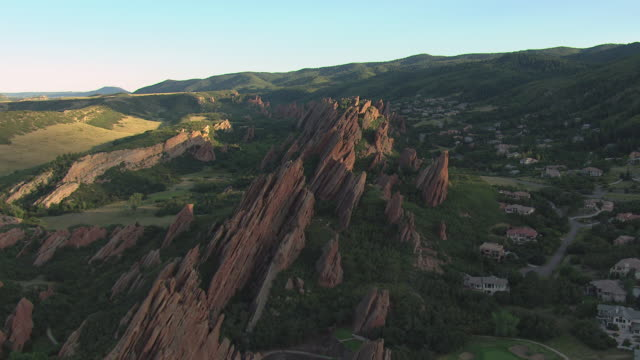 ws ds zi aerial view of red sandstone formations jutting into air with shrubs growing in roxborough state park in douglas county / colorado, united states - state park stock videos & royalty-free footage