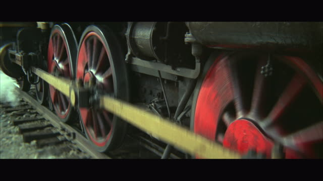CU TS View of red steam train wheels moving forward