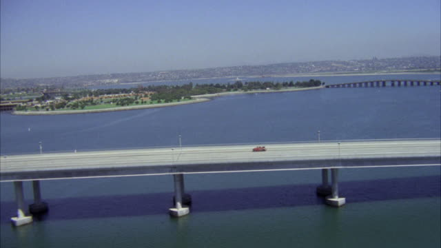 aerial ws ds view of red volkswagen convertible on san diego freeway - 1980 stock videos and b-roll footage
