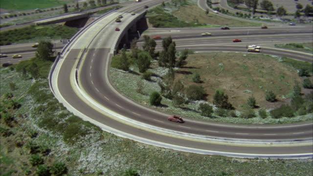 aerial ws view of red volkswagen convertible on san diego freeway - volkswagen stock-videos und b-roll-filmmaterial