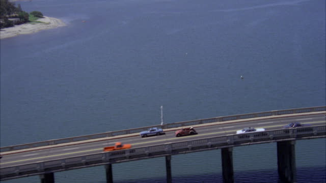 aerial ws view of red volkswagen convertible on san diego freeway - 1980 stock videos and b-roll footage