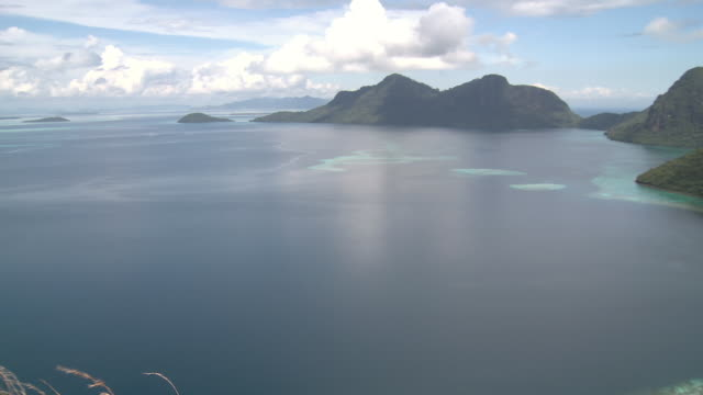 ms pan view of reef and islands / semporna, sabah, malaysia   - sabah state stock videos and b-roll footage