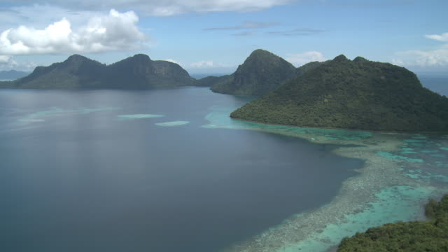 ws view of reef and islands / semporna, sabah, malaysia   - sabah state stock videos and b-roll footage