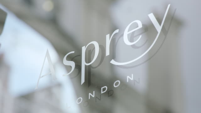 CU R/F View of reflection in window to focus on Asprey sign / London, United Kingdom