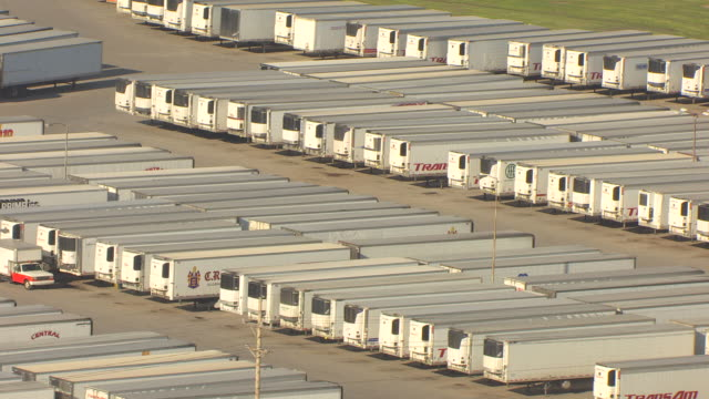MS AERIAL ZO View of refrigerated trucks at Cargill Meat Processing Plant parking / Dodge City, Kansas, United States