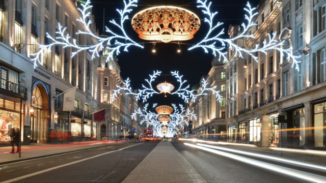WS ZI T/L View of Regents Street night with Christmas lights central reservation with traffic and pedestrians / London, Greater London, United Kingdom